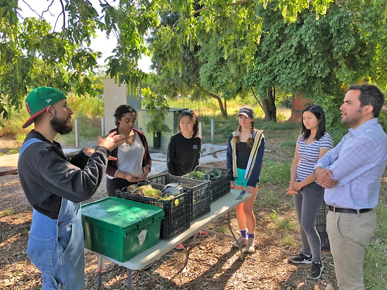 Photo of Yanez and workers at UC Davis student farm.