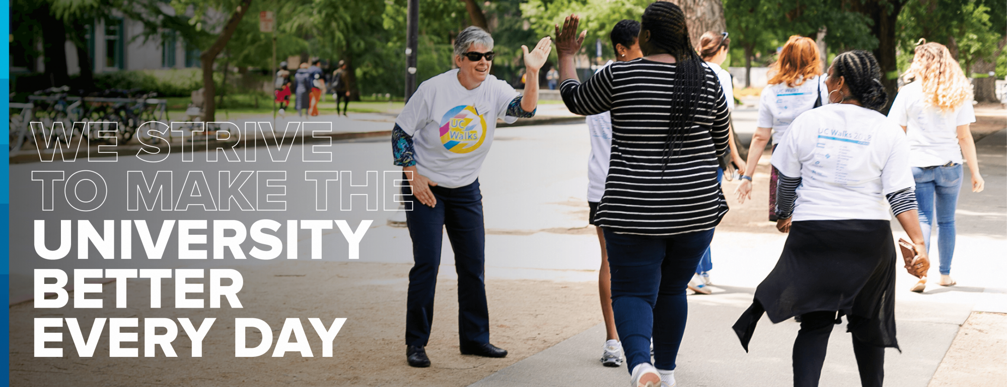 """We strive to make the university better every day."" Vice Chancellor Kelly Ratliff high-fives collagues during UC walks event"