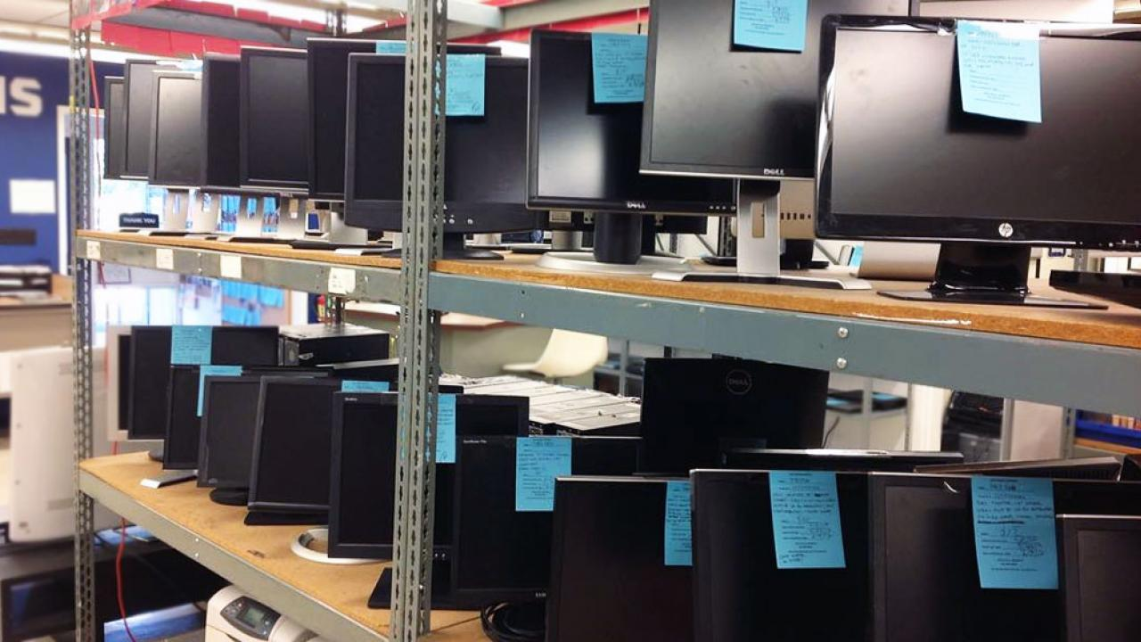 Photo of surplus computers for sale.