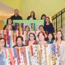 Photo of group with quilts