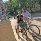 Photo of Kirk and Yanez on bicycles in Davis California.